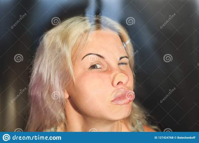 female-face-pressed-against-glass-window-funny-female-face-expression-female-face-pressed-against-glass-window-127424768